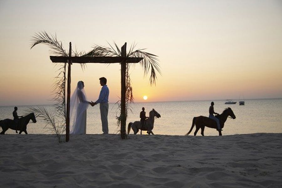 Anantara Bazaruto - bridal couple on the beach